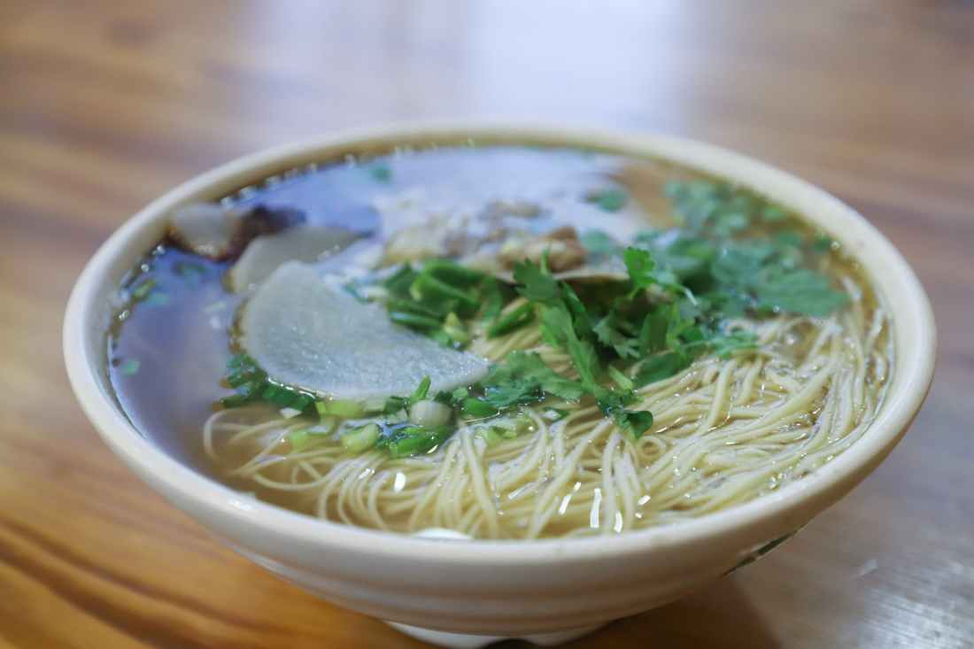 cooked noodle with garnish